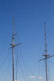 Two Tall Masts on Blue Stock Photos