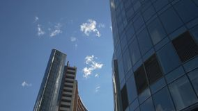 Two tall office buildings stock video