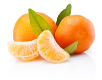 Two tangerines with leaves and peeled pieces isolated on white background. Two tangerines with leaves and peeled pieces isolated on a white background stock images