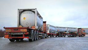 Two Tank Trucks Haul Flammable Goods. SALO, FINLAND - JANUARY 17, 2015: Two tank trucks haul flammable goods. The ADR label 50-1495 stands for sodium chlorate Stock Photography