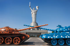 Two tanks against the background of the monument. In Kiev Royalty Free Stock Photography