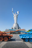 Two tanks against the background of the monument. In Kiev Stock Photography