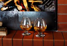 Two tanks of cognac on the old brick fireplace Stock Image