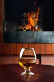 Two tanks of cognac on the old brick fireplace Royalty Free Stock Image