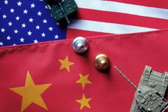 Two tanks face to face on USA and China national flag background. Refer to conflict between two countries is heating up. China and. Chess pawn stand against each stock photo