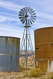 Two Tanks, One Windmill Stock Image
