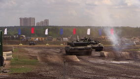 Two tanks of the Russian army moving on the ground. T90-A jump shot on the ramp stock footage