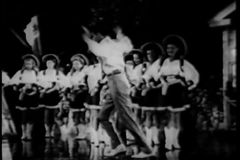 Two tap dancers performing on stage with cowgirl backup dancers stock video footage
