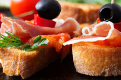 Two tapas with jamon with tomato. And olives closeup Stock Image