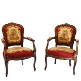 Two tapestry chairs. Two english antique tapestry chairs decorated with flowers and couple isolated on white background Stock Images
