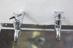 Two taps and stainless steel kitchen sink Royalty Free Stock Image