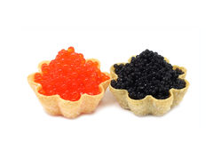 Two tartlets with black and red caviar Stock Photos