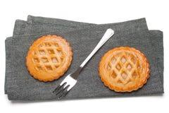 Two tarts on grey napkin Stock Image