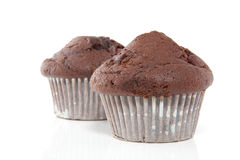Two tasteful chocolate muffins Stock Photos