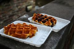 Two tasty Belgian waffles with chocolate and caramel stock photography