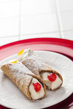 Two Tasty Cannoli on Plate Stock Photo