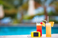 Two tasty cocktails with camera on tropical white beach Stock Image