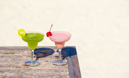 Two tasty cocktails on tropical white beach Stock Photography