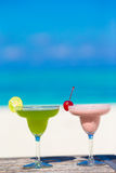 Two tasty cocktails on tropical white beach Royalty Free Stock Image