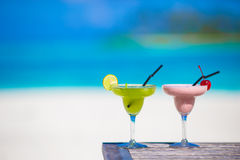 Two tasty cocktails on tropical white beach Royalty Free Stock Photography