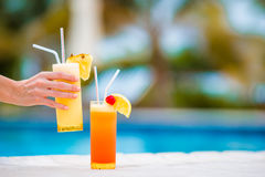Two tasty cocktails on tropical white beach Stock Images