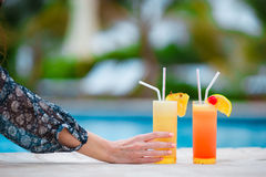 Two tasty cocktails on tropical white beach Royalty Free Stock Photos