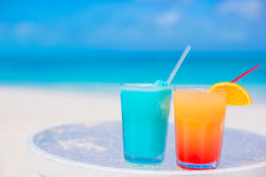 Two tasty cocktails on tropical white beach Royalty Free Stock Photo