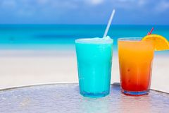 Two tasty cocktails on the white sandy beach Royalty Free Stock Photo