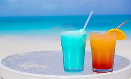 Two tasty cocktails on the white sandy beach Royalty Free Stock Image