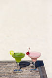 Two tasty cocktails on wooden table at tropical Royalty Free Stock Photo