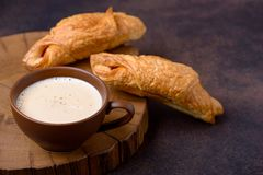 Two tasty croissants and coffee cup Stock Photos