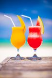 Two tasty fruits cocktails on background of Stock Images