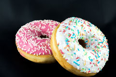 Two tasty but unhealty donuts Stock Image