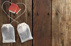 Two tea bags with threads laid out in a heart shape Royalty Free Stock Photos