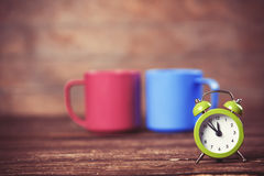 Two tea cup and alarm clock Royalty Free Stock Image