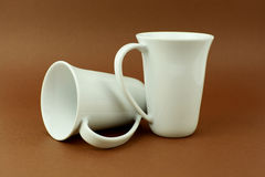 Two tea cups on brown background.  Stock Photo
