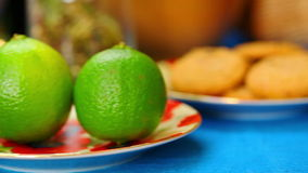 Two Tea cups with green lime near stock video