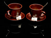 Two tea cups with teaspoons Stock Images
