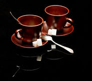 Two tea cups with teaspoons Royalty Free Stock Photo