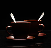 Two tea cups with teaspoons Stock Photos