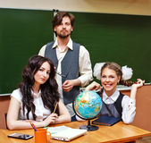Two teachers and pupil geography lessons. Royalty Free Stock Photography
