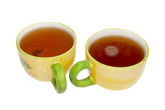Two teacups with tea. Stock Photo