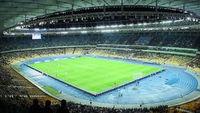 Two teams play football, official match, stadium arena evening. Stock footage stock video footage