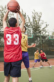 Two teams playing basketball Royalty Free Stock Images