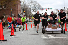 Two Teams Race Beds On City Street Royalty Free Stock Photos