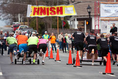 Two Teams Race Beds To Finish Line In Fundraiser Royalty Free Stock Images