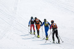 Two teams of ski mountaineers climb the mountain on skis. Team Race ski mountaineering. Russia, Kamchatka Stock Image