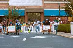 Two Teams Sprint To Finish Of Bed Race Royalty Free Stock Photography