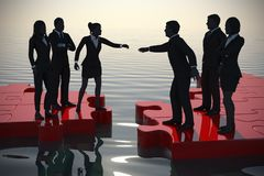 Merger of two teams on a jigsaw puzzle at sunset. Two teams of successful executives merging on a jigsaw puzzle at sunset showing a partnership Stock Photo