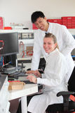 Two technicians at work in a laboratory Stock Images